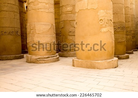 columns covered in hieroglyphics, Karnak, Egypt. - stock photo