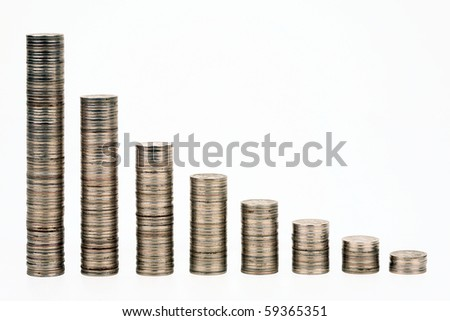 Columns from coins representing the credit status schedule - stock photo