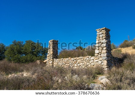 Columns from the porch of an abandoned ranch ruins in the Mojave Desert of California. - stock photo
