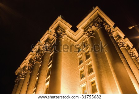 Columns of a building. A night photo, light from street lanterns