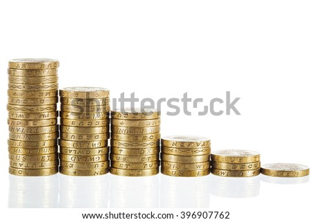Columns of British Pound Sterling coins in decreasing heights, symbolising steep economic losses and recession. Isolated on white background.