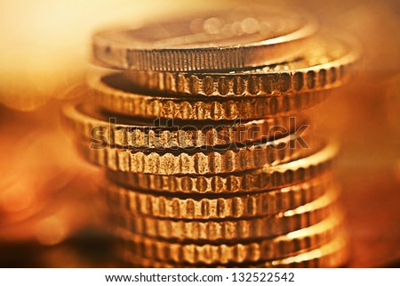 Columns of euro coins. Very small depth of field. - stock photo