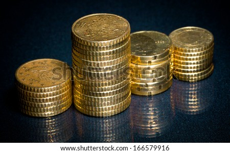 Columns of golden coins - stock photo