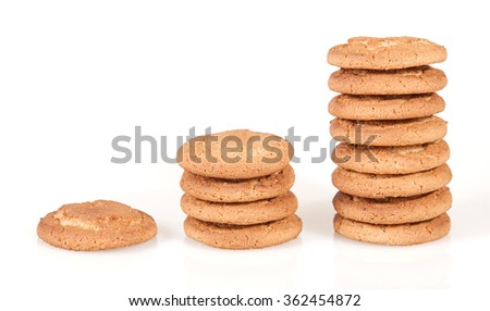 Columns of oatmeal cookie on white background