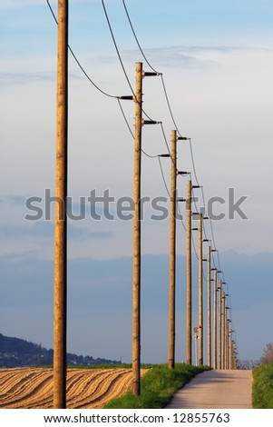 Columns of power cable lines distributing electricity