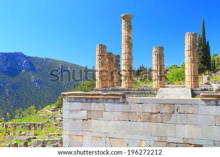 Columns of the temple dedicated to Apollo at Delphi, Greece - stock photo