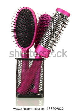 Comb brushes in metal holder , isolated on white - stock photo