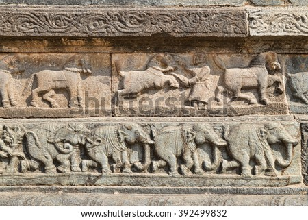 Combat elephants and horses indian temple bas relief - stock photo