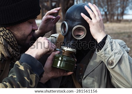 Combat getting equipped with the gas mask - stock photo