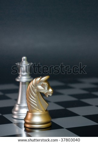 Combination from chessmen on an old board - stock photo