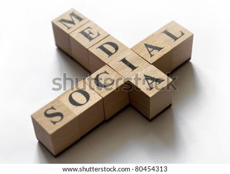 "Combination of the words ""social"" and ""media"" composed of cubes. Focused on ""I"" letter. Isolated on white. - stock photo"