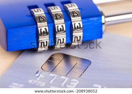 Combination padlock on credit card concept security - stock photo