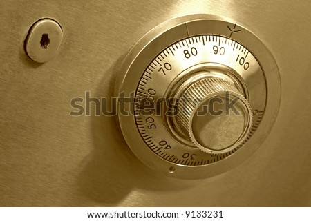 Combination safe lock, in golden duotone. - stock photo