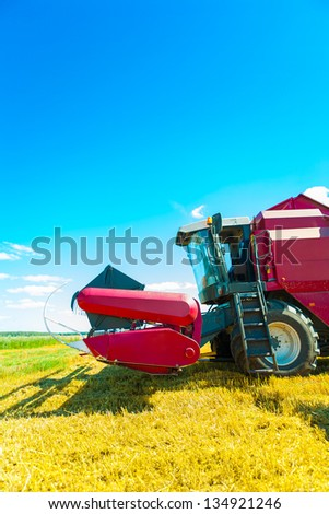 combine harvester closeup - stock photo