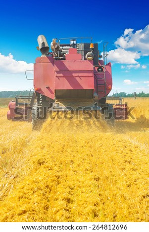 combine harvester in work rear view agricultural concept  - stock photo