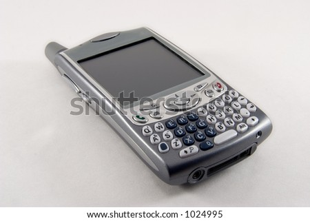 Combined cell phone and Personal Digital Assistant (PDA). Isolated on white background. - stock photo