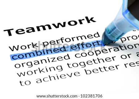 Combined effort highlighted in blue, under the heading Teamwork. - stock photo