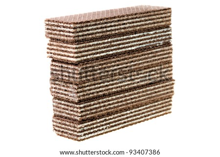 Combined one on another chocolate wafers. It is isolated on a white background. Small depth of sharpness - stock photo