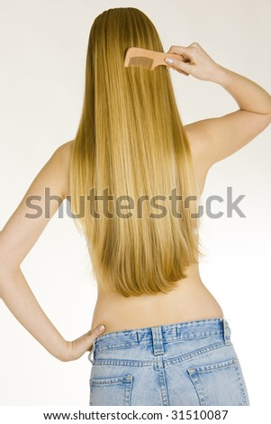combing woman wearing jeans - stock photo