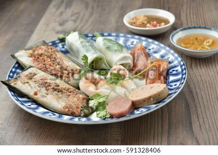 Combo of mix Hue cake: banh beo, banh bot loc, banh nam (Hue cakes) eaten along with fish sauce.
