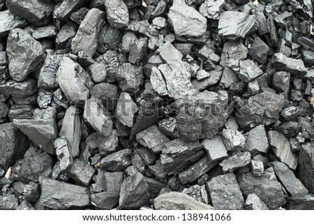 Combustion coal pile - stock photo