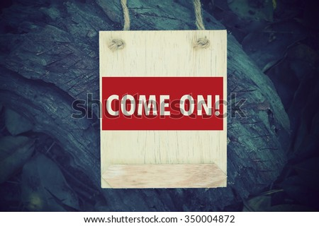 COME ON:  Inspiration Motivational Life Quote on Wood Frame Background Design.