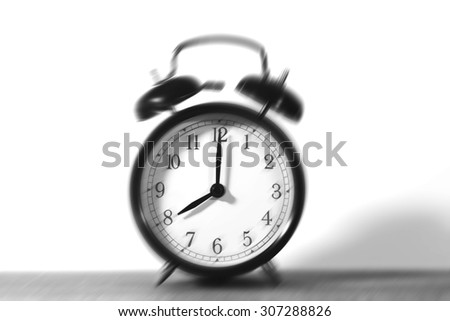 Come on - time to wakeup and hurry for work. It's eight o'clock already. A blur effect is applied on the bells to emphasize the wakening.