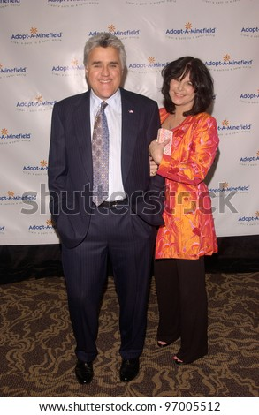 Comedian JAY LENO & wife MAVIS at the 4th Annual Adopt-A-Minefield Gala at the Century Plaza Hotel, Beverly Hills, California. October 15, 2004 - stock photo