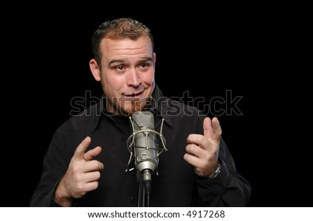 Comedian performing on a black background