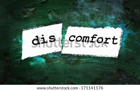 Comfort and discomfort written on piece of paper - stock photo
