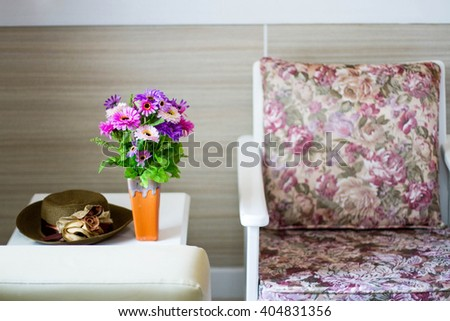 Comfortable armchair with pillows and blanket against white wall background - stock photo