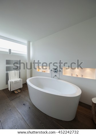 comfortable bathroom in modern design, bathtub in the foreground