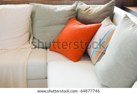 Comfortable corner in family room, with multi-colored pillows. - stock photo
