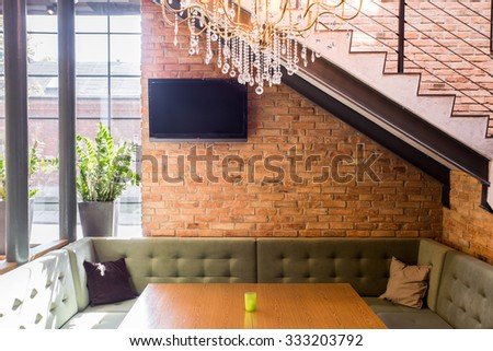 Comfortable couch and table in contemporary loft interior - stock photo
