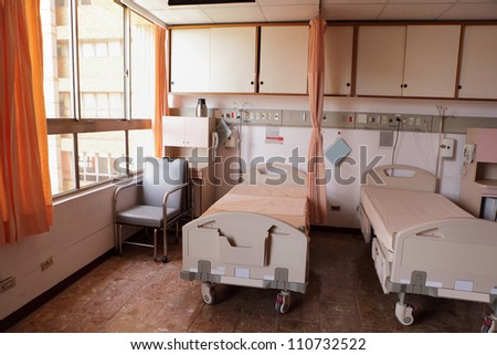 comfortable equipped hospital room with bed - stock photo