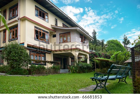 Comfortable hotel with the green park and garden - stock photo