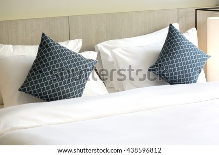 Comfortable pillows and bed - stock photo