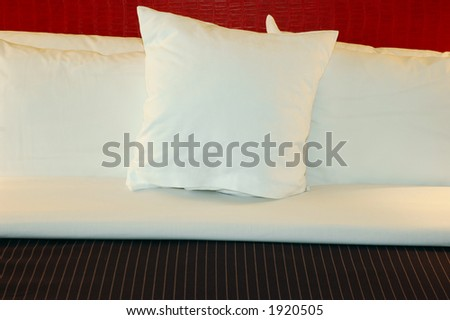 Comfortable pillows on a bed - stock photo