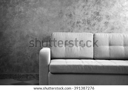 Comfortable sofa against grey wall in the room, close up - stock photo