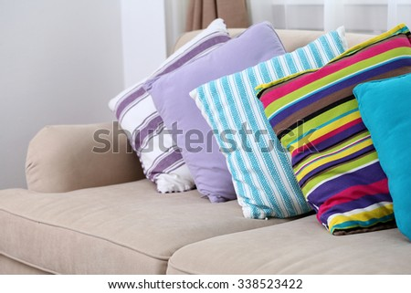 Comfortable sofa with colourful  pillows in the room, close up - stock photo