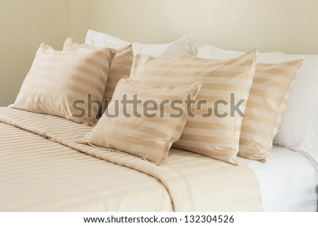 Comfortable soft pillows on the bed - stock photo