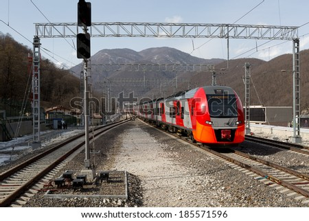 "Comfortable train ""Swallow"" at the entrance to the station in Krasnaya Polyana. Sochi - stock photo"