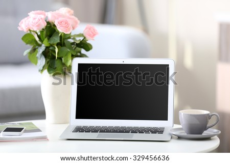 Comfortable workplace at home with laptop - stock photo