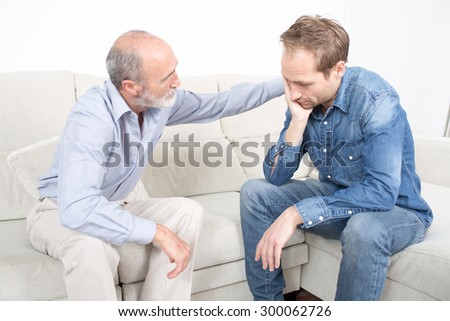 comforting the son - stock photo