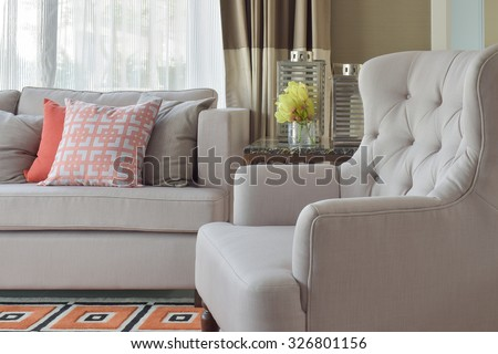 Comfy beige arm char with chinese style in orange theme living corner - stock photo