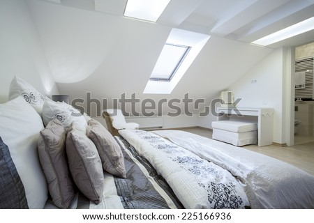 Comfy enormous bed in bright bedroom, horizontal - stock photo