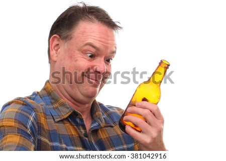 Comic image of a Middle Aged Man Drinking a Bottle of Beer isolated on white - stock photo