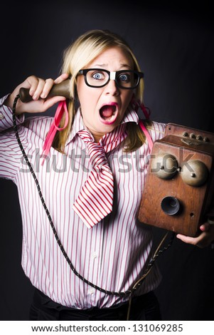 Comic Portrait Of A Nerdy Female Member Of Staff Holding Old Bell Phone With Shocked Expression When Hearing Bad News Announcement