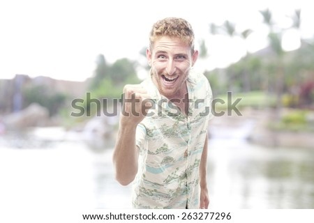 comical ginger young man with hawaiian shirt - stock photo