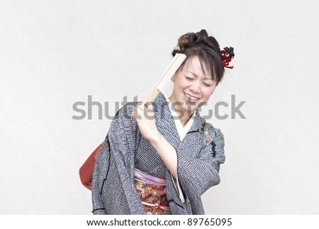 Comical woman in a kimono - stock photo